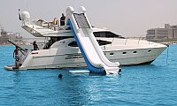 Private Luxury Yacht Charter with water Slide Activities at 2799AED