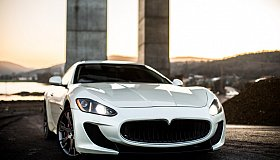 white-coupe-sport-car-standing-road-front_grid.jpg